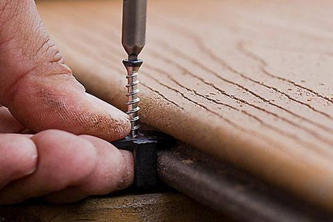 Trex hidden fastening system closeup, hands screwing in