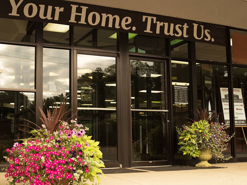 Novi Home Design Center exterior entrance showing Your Home, Trust Us banner
