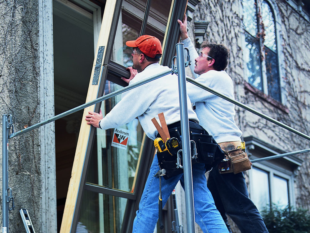 2 men installing a window